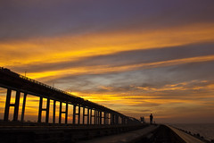 The pamban spectacle (Kals Pics) Tags: bridge sunset sea sky colors beauty silhouette train canon landscape colours pov magic perspective tranquility railway wideangle fantasy hues serenity serene tranquil rameswaram 550 southernrailway bayofbengal cwc leadinglines pamban indianrailway pambanbridge gulfofmannar palkstrait kalspics chennaiweekendclickers 18135mmis palkbay