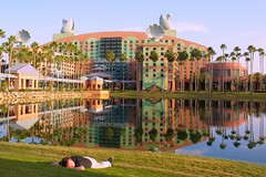 Soakin' It In (Brian Utesch (shutterBRI)) Tags: blue trees sleeping sky sun lake man reflection water grass canon reflections hotel orlando epcot still swan nap florida sleep dolphin disney resort disneyworld napping wdw waltdisneyworld 2012 laying swanhotel dolphinhotel shutterbri brianutesch