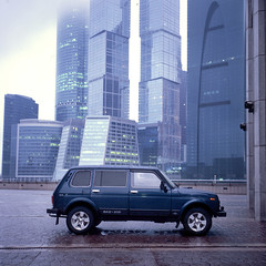 Moscow city (Anton Novoselov) Tags: city blue sky 120 6x6 film car rain weather rolleiflex square grey fuji russia moscow bad slide velvia chrome medium format lada niva e2