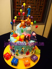 Winnie the Pooh birthday cake (Jcakehomemade) Tags: party bees balloon celebration birthdaycake winniethepooh block tigger piglet eeyore firstbirthdaycake charactercake funcake hunnypot fondantcake poohcake cartooncake poohandfriendscake 3dbirthdaycake wwwjcakehomemadeblogspotcom figurinescake jessicalaw designerbirthdaycake customizedbirthdaycake winniethepoohthemebirthdaycake kidnoveltycake timmysbirthdaycake