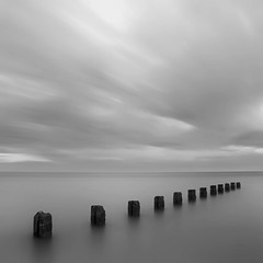 Sequence (andrew_v) Tags: longexposure bw seascape beach monochrome square landscape nikon florida unitedstatesofamerica fineart pilings clearwaterbeach clearwater neutraldensity colorefexpro niksoftware silverefexpro andrewvernon nikond300s aperture3