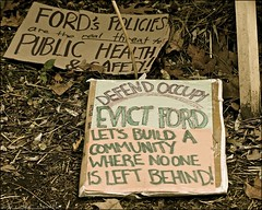 defend occupy / evict ford .... (ana_lee_smith) Tags: portrait toronto wednesday lens photography movement downtown library photojournalism police peaceful gazebo beercan yurt stjamespark civildisobedience resistance global socialdocumentary eviction kingst officers thefaceof analeesmith minoltaaf70210mm sonyalphaa33 occupytoronto occupyingtoronto nov23rd2011 metropolitantorontopoliceforce