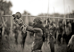 Donga stick fighting in Surma Suri under the rain - Ethiopia (Eric Lafforgue) Tags: man rain fight artistic profile culture pluie tribal ornament tribes violence warrior stick shield bodypainting tradition tribe ethnic rite surma tribo headdress adornment pigments headwear ethnology headgear tribu eastafrica thiopien suri etiopia ethiopie etiopa seapia  etiopija ethnie ethiopi  shiled etiopien etipia  etiyopya  nomadicpeople         peoplesoftheomovalley