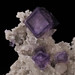 Fluorite with phantoms on Calcite