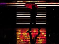 coloured up // sankt pauli, hamburg (pamela ross) Tags: street reflection rain silhouette pen umbrella germany lights walk hamburg olympus stpauli passerby reeperbahn kiez ep1 sanktpauli
