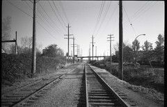 there's someone there (Beaulawrence) Tags: road camera railroad winter panorama white canada black fall film lines vancouver analog train 35mm point lomography shoot december bc power pentax grain tracks rail down mini columbia panoramic scan automatic plus hp5 british 135 pocket ilford 2011 espio sooc