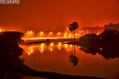 another world of another century (gspphotography) Tags: shadow red urban lake art night photography haze cityscape dhaka bangladesh shagupta gettyimagesbangladeshq2 gettyimagesbangladeshq12012