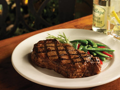 7041A Natural Ribeye With Green Beans (majesticstar) Tags: christmas wood party summer irish white english fall glass horizontal easter french spring bottle italian natural traditional beverage gourmet american steak peas peppers newyears rib superbowl grilling fathersday boneless mothersday valentinesday 2010 ribeye warmcolors darkbackground grillmarks generallibrary grillingseason roundplate 4rhofjuly fullusagerights creditphotographer teristudios veggymix