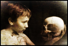 A Future Held in His Hands (Jeff Gish Photography) Tags: boy white black sepia youth death skull blood darkness thoughtful future processed