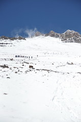 Groups heading up the normal route - strong winds can be seen blowing snow higher on the mountain (nic0704) Tags: aconcagua mountain andes peak summit 7 glacier snow rock climb climbing mountaineering scale highest mendoza argentina altitude south america polish traverse plaza de mulas basecamp base camp