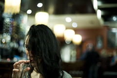 girl drinking in bar (gorbot.) Tags: girl bar glasgow f14 roberta canoneos5d nikonfmount planar5014zf carlzeisszf50mmplanarf14 eosadaptor
