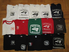 "Collection of different ""Hecho en Mexico"" T-Shirts in green, white, red, and black from Tijuana, Guadalajara, Nogales Sonora and Puerto Vallarta, Mexico (RYANISLAND) Tags: travel en art tourism shop shirt shopping mexico town photo store folkart image eagle photos folk traditional bordertown border tshirt images collection mexican souvenir gifts shirts gift momento buy tijuana tshirts tradition stores mx teeshirt eagles collect tj collector mex teeshirts stockphoto buying keepsake hecho hechoenmexico tijuanamexico graphictee stockimage madeinmexico mexicaneagle graphict hechoen tijuanamex tijuanamx hechoenmexicoshirt hechoenmexicotshirt"