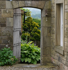 Take the open door (Lancashire Lass ...... :) :) :)) Tags: door flowers trees house garden countryside bell explore archway