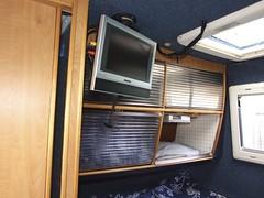 Locker at foot of rear bed. Heki rooflight above, small tv in corner (Mudman101) Tags: fiat motorhome ducato
