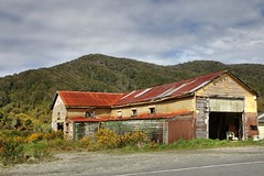 Old lodge, Taylorville, West Coast, New Zealand (brian nz) Tags: old newzealand house building abandoned home rural river grey ruins decay shed lodge westcoast derelict boarding dilapidated taylorville deterioration oldandbeautiful oncewashome