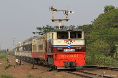 Express train to Mawlamyaing pulled by DF1200.04 (Alsthom 1957) is entering Abaya station (florian_grupp) Tags: railroad tree station train bush asia diesel burma colonial tracks engine railway loco bluesky rails british myanmar locomotive southeast alstom signal railways abaya semaphore narrowgauge passengertrain 1000mm expresstrain dieselelectric abya alsthom semaphoresignal metergauge staterailways myanmarailways df1204 df120004
