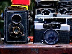 Down on the corner (Bharat Chintapalli) Tags: india voigtlander cameras mumbai olympuspen oldisgold cameraporn oldcameras rollieflex rolliecord