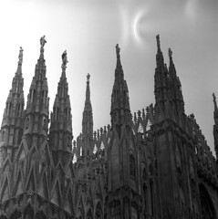 055059 12 (ndpa / s. lundeen, archivist) Tags: city blackandwhite bw italy milan detail building 6x6 tlr film church stone architecture mediumformat blackwhite italian europe cathedral spires details nick gothic may architectural 1950s damaged figures sculptures 1959 duomodimilano gothiccathedral dewolf northernitaly triptoeurope milancathedral nickdewolf photographbynickdewolf