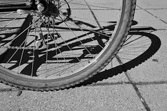 SHADOWS (DESPITE STRAIGHT LINES) Tags: street shadow canada bike bicycle wheel nikon shadows bc tire chain cycle sidney tyre d700 ilobsterit