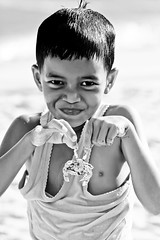 #850C9649- Smile of success (crimsonbelt) Tags: portrait beach smile kids crab success balikpapan melawai