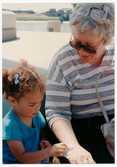 Washing Grandma's arm (kewzoo) Tags: love senior girl children togetherness kid toddler child grandmother tissue cleaning grooming grandchild biracial 1980s connection tenderness age3 wiping phototrove