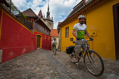Cycling through Sighisoara -Romania (David Sear) Tags: travel blue red green church bike yellow ride action explore cycle romania exodus