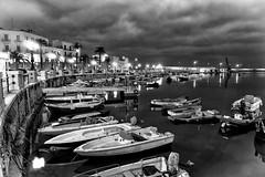 Nuvole su Bari (FrancescoPalmisano) Tags: blackandwhite night clouds boats harbor italia nuvole mare nightscape barche porto puglia bari