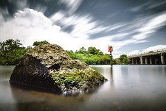 Shore Snoopin' (Stephen Oliveira) Tags: longexposure bridge sky water field rock clouds river florida outdoor sony sigma depthoffield 1020 depth haida palmbay indianriver ndfilter sigma1020 10stop 10stopndfilter a6000 stephenoliveira haida10stop sonya6000