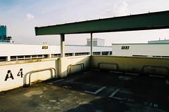 Lazy Sundays (OzGFK) Tags: asia singapore jurongeast hdb carpark rooftop street streetphotography film analog nikon nikkor sunset empty