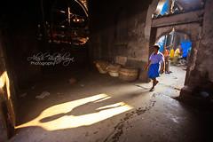 Framed | Kolkata (@k@sh) Tags: game flower sports bike 35mm canon kid market sleep candid wrestling indian traditional f2 kolkata ghat akash 35mmf2 kushti 550d mullick didnotfire exif:iso=800 exif10mm exifoff exiff40