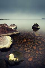 Polarized (- David Olsson -) Tags: lake nature water landscape nikon rocks cloudy sweden stones sigma overcast pebbles karlstad 1020mm polarizer polarized 1020 vnern cpl vrmland hss polarizingfilter lakescape skutberget d5000 davidolsson sliderssunday ginordicdec