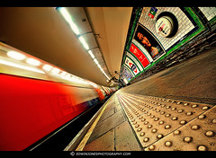 TheTrain Now Arriving (Edwinjones) Tags: pictures city uk blue light red england urban color colour building london art texture lines architecture train buildings underground photography lights design photo movement colours metro photos sony tube perspective platform picture trails sigma wideangle pic motionblur tubestation londonunderground dslr northern northernline tooting tubetrain undergroundstation tootingbec centralperspective dslra700