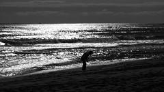 'searching for a gem' (16:9) (David Willis.) Tags: blackandwhite espaa sun man beach silhouette clouds boat spain sand looking bent 169 malaga fuengirola bentover 169format davidwillis canong10