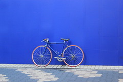 Bicycle against a blue background in Japan
