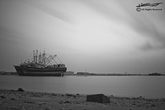 Seascape with Infrared filter (Yousef Zaman) Tags: sunset sea sky bw white black beach canon boat ship filter infrared zaman 60d