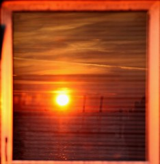 window sunset (J Cianfrani Photography) Tags: sunset sun reflection window water clouds bay newjersey dock nj margate flickraward blinkagain