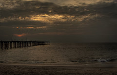 Sunset at alappuzha (Navaneeth K N) Tags: bridge sunset red sea sky india beach clouds canon landscape day cloudy kerala arabian 28135 hdr arabiansea 500d alappuzha navaneeth flickraward t1i navaneethkn