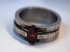 Iron and Ruby Ring (the justified sinner) Tags: leica macro found iron object jewelry ring panasonic jewellery 28 ruby 45mm corundum gaspipe elmarit tensionset justifiedsinner