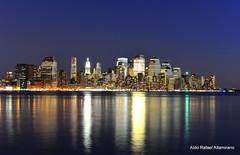 Dowtown New York (Rafakoy) Tags: city nyc newyorkcity longexposure light urban ny color reflection water colors skyline night digital reflections lights newjersey cityscape dusk manhattan scenic hoboken afsnikkor18105mm nikond7000