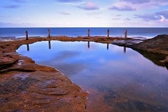 Mirror Mirror (Ozzify) Tags: ocean longexposure shadow sea seascape reflection texture nature pool clouds swimming fence mirror evening movement horizon australia motionblur poles tidal rockpool southcoogee ivorowe ozzify