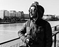 (graveur8x) Tags: man photographer portrait blackandwhite frankfurt germany deutschland monochrome fuji xt1 camera sunglasses cool cold river main water buildings city hat coat