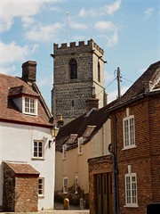 TheTower (Hodd1350) Tags: houses windows tower church clouds stonework olympus roofs dorset flagpole chimneys brickwork wareham penf zuikolens