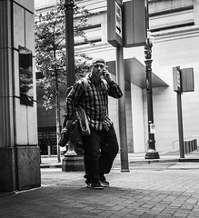 Where Are You? (TMimages PDX) Tags: road street city people urban blackandwhite monochrome buildings portland geotagged photography photo image streetphotography streetscene sidewalk photograph pedestrians pacificnorthwest avenue vignette fineartphotography iphoneography