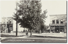 Division Street looking south, Bristol, Indiana (Hoosier Recollections) Tags: horses people woman usa signs man men history boys kids buildings bristol walking advertising children clothing women shoes hats indiana streetscene bicycles transportation shops pedestrians storefronts buggy buggies businesses wagons lampposts realphoto elkhartcounty hoosierrecollections