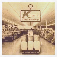 """Interior of a 1970s Kmart; from """"The Grand Emporiums"""" by Robert Hendrickson (Joe Architect) Tags: retail yourfavorites cameraphone favorites joesgreatesthits myfavorites bw"""
