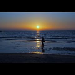 solitarie riflessioni (s@brina) Tags: sunset sea sun man reflections mare ombra uomo solitary riflessi solitario explorefrontpage