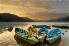 Fewa Lake Sunset, Pokhara, Nepal (Souvik_Prometure) Tags: nepal sunset sunrise boats boat kathmandu pokhara annapurna hdr sarangkot nagarkot phewalake photomatix fewalake phewatal photomatixpro tonemapping sarankot tonemap machapuchare abigfave flickrdiamond tokina1116mmf28 tokina1116mm topazadjust nikond7000 souvikbhattacharya mountannapurna mountmachapuchare