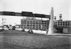 New viaduct for westbound traffic from the Holland Tunnel with 1950s neon signs for Newark, Philadelphia and Hudson Boulevard. Lots of 1940s cars and the Emerson radio factory. Jersey City, New Jersey. 1953 (wavz13) Tags: blackandwhite industry industrial cobblestones futurism oldcars vintagecars vintageneon vintageneonsigns 1950scars oldneon vintageindustrial oldurban oldneonsigns oldjerseycity 1940scars vintageindustry jerseycityhistory vintageurban vintagejerseycity urbanfuturism 1950sjerseycity 1940sjerseycity 1950sneonsigns 1950sneon 1940surban