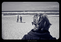 What's going on there? (Photastrophic) Tags: sky people woman cloud sunlight man nature water girl sunglasses clouds landscape coast photo blackwhite sand warm waves wind pentax bokeh head balticsea jacket handheld desaturated shoulder 50mmf14 k10d pentaxk10d