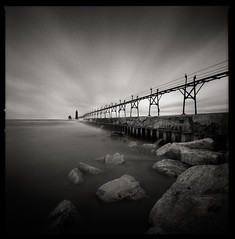Grand Haven Pier (Jeff Gaydash) Tags: longexposure blackandwhite lighthouse film square pier seascapes michigan lakemichigan greatlakes hasselblad grandhaven lakescapes 903swc